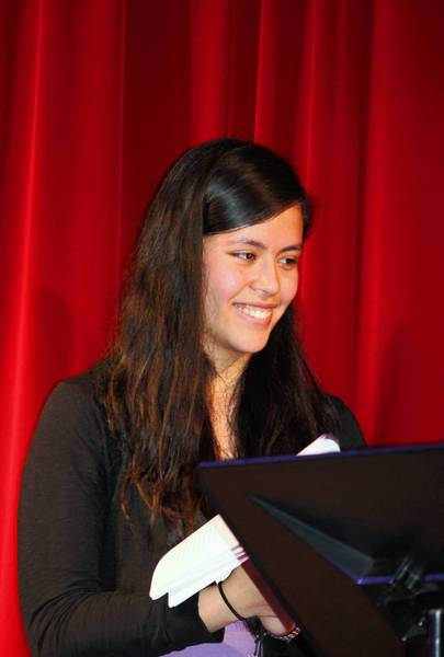 Eighth grader Aurora Zamudio takes part in a poetry slam May 16 at Northwood School in Highland Park.