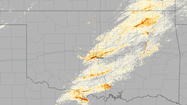 "Images showing the massive tornadoes spawned by ""super cell"" thunderstorms over Oklahoma, and the scars they left behind, have been released by NASA and the National Oceanic and Atmospheric Administration."