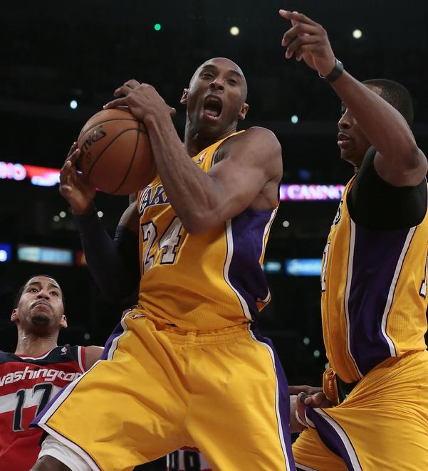 Lakers star Kobe Bryant, center, in action.