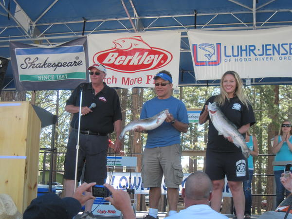 Alan Sharp, left, tournament director of the Fishin' for $50K Trout Derby, introduces the winners of the 2011 largest-trout contest, Robert Kimura of Los Angeles and Maria Leverett of Victorville.