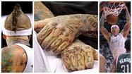 "His first tattoo? Chris ""Birdman"" Andersen turns over his left forearm. He points to a Chinese symbol in black ink amid the body by Brito."