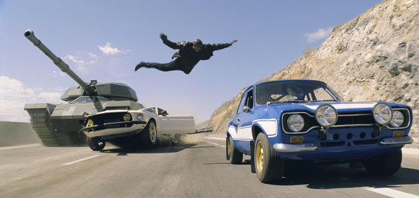 In a scene from 'Fast & Furious 6' Roman, played by Tyrese Gibson, leaps from his 1969 Anvil Mustang onto a Ford Escort Mark 1, driven by Paul Walker's character.