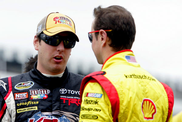Kyle Busch, left, with brother Kurt. (USA Today Sports Photo)