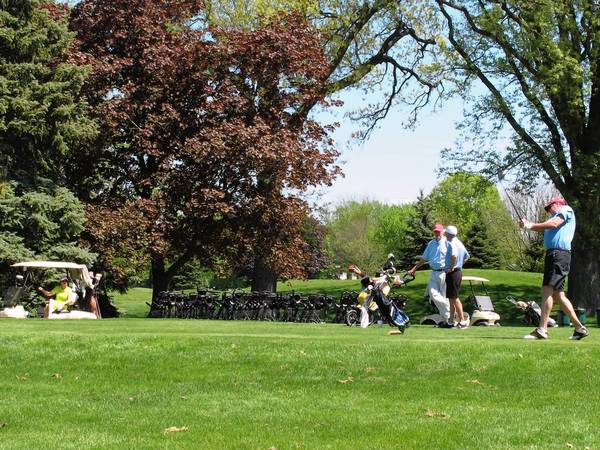 Golfers enjoy a beautiful day at the Wilmette Golf Club. The course will close on July 29 for a $2 million renovation intended to improve stormwater drainage. It's expected to reopen in May or June 2014.