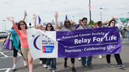 Beth Amato, UTC Senior Vice President, Human Resources and Organization, at left is joined by, second from left, Amy Sunshine from Country 92.5 FM, and far right Peg Camp, Senior VP of Operations of the New England Division of the American Cancer Society, with others in the Survivors Lap.