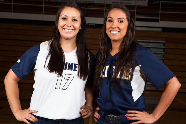 Trine University's Andi Gasco (left) and Carly Searles, former Petoskey High School standout softball players, recently made Trine softball history as the sister duo because the team's first two All-American's in the 28-year history of the program.