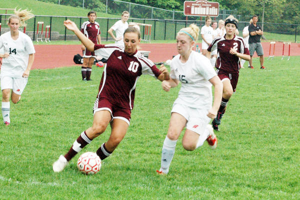 Charlevoix senior forward Hannah Herboldsheimer (left) brings tries to make a move on East Jordan defender Chelsea Joki during Mondays Lake Michigan Conference match at Boswell Stadium in East Jordan. Herboldsheimer had a pair of goals as the Rayders defeated the Red Devils, 8-0.