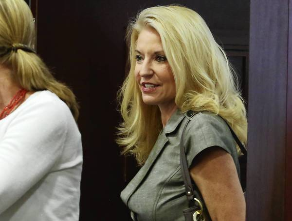 Caryn Kelley enters the Orange County courtroom Tuesday, May 21, 2013 during the manslaughter trial of Caryn Kelley, who is accused in the fatal shooting of her boyfriend after a drunken argument at her College Park home in 2011.