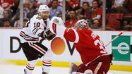 As Blackhawks teammates tracked back and forth in various states of post-loss gloom late Monday, Patrick Sharp sat silent in a shoebox-sized anteroom to the main visitor's dressing area at Joe Louis Arena, hands folded and staring straight ahead.