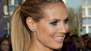 Heidi Klum bribes her kids to eat healthy. Well, that's a new one for the celebrity parenting handbook.