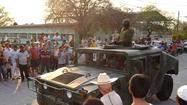 MEXICO CITY -- The Mexican government poured army troops -- and high-level delegations -- into western Mexico on Tuesday in a bid to take back control of a region long besieged by a deadly drug cartel.