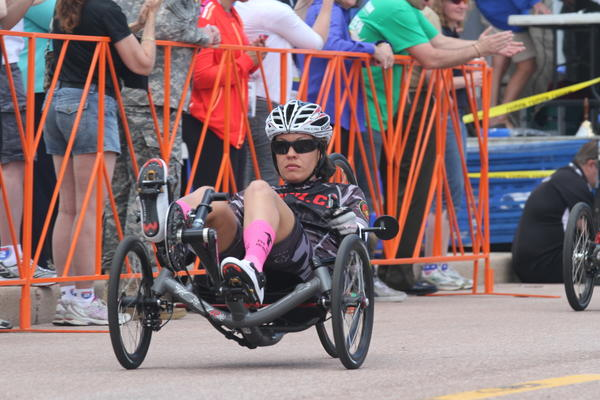 Sgt. Lorie Yrigoyen, with Wounded Warrior Battalion West, won a gold medal in the women's 10k recumbent hand-cycle race.