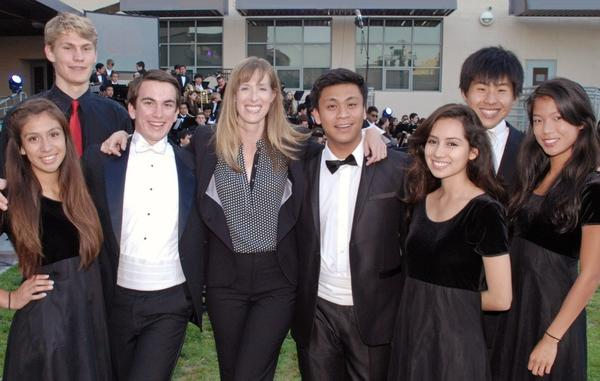 Preparing for their Burroughs Bowl performance are, from left, Ashley Velasco, Shayne Beamer, Jack Harman, JBHS Music Director Tana Barnett, Gabe Joven, Gilma Bernal, Jason Tom and Garcia Innocentia.