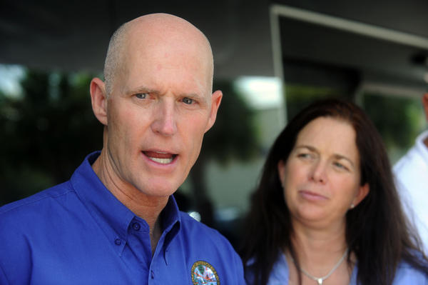 Melissa Meeker, shown here with Gov. Rick Scott touring flooded areas after Tropical Storm Isaac in 2012, resigned Monday as executive director of the South Florida Water Management District.