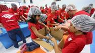 Orlando area group packs thousands of meals for Oklahoma tornado victims