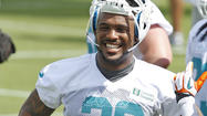 Miami Dolphins cornerback Jamar Taylor has missed the start of the team's Organized Team Activities, but he's got a pretty good excuse.