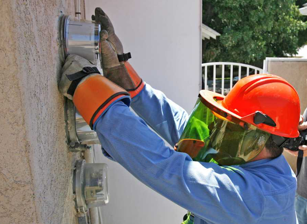 FILE PHOTO: A Glendale Water and Power worker installs a smart meter.