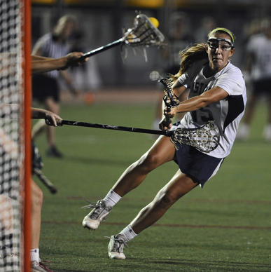 Marriotts Ridge's Zoe Stukenberg shoots and scores her team's 12th goal of the game in the second half.
