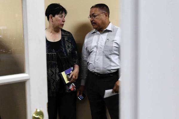 Dolton Trustee Cathern Bendell, left, and Mayor Riley Rogers visit the Dorchester Senior Center, a village-owned apartment complex, on Tuesday.