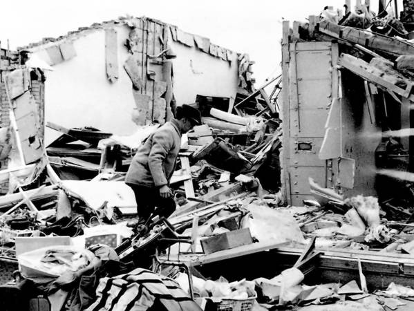 A man searches for belongings after the 1967 tornado near 94th Street and Menard Avenue in Oak Lawn.