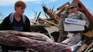 MOORE, Okla. — The FM radio airwaves in Moore and adjoining Oklahoma City were clogged Tuesday with pastors, church members and ordinary citizens phoning in to offer food and shelter to neighbors left homeless by a powerful tornado that killed at least 24 people here Monday afternoon.