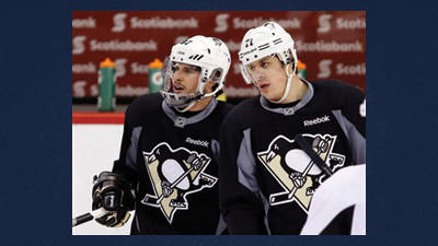 Pittsburgh Penguins captain Sidney Crosby, left, talks with teammate Evgeni Malkin during the team's practice ahead of Game 4 in their NHL hockey Stanley Cup playoffs Eastern Conference semifinal against the Ottawa Senators.