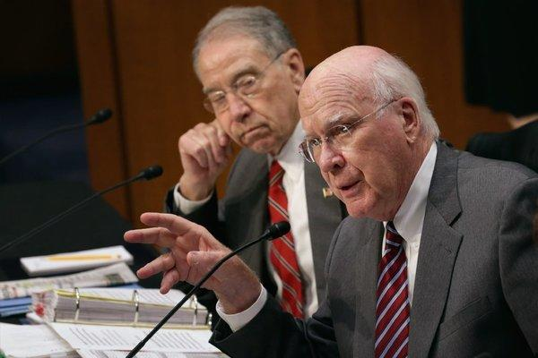 Senate Judiciary Committee Chairman Patrick Leahy (D-Vt.), right, and ranking member Sen. Charles Grassley (R-Iowa) debate on Capitol Hill during a markup session for the immigration reform legislation.