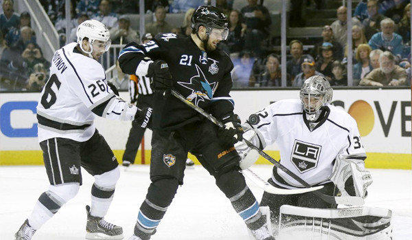 T.J. Galiardi's shot is knocked down by Jonathan Quick during Game 4 of the Kings' Western Conference semifinal matchup with the San Jose Sharks on Tuesday.