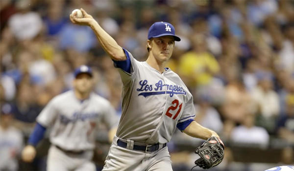Zack Greinke's gave up five runs on nine hits through four innings with three walks and a strikeout during the Dodgers' loss to the Brewers, 5-2.