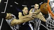 (Reuters) - San Antonio squandered a big lead in the fourth quarter and had Tim Duncan to thank for settling their nerves in overtime as the Spurs ground out a 93-89 win over the Memphis Grizzlies and took a 2-0 lead in the Western Conference finals on Tuesday.