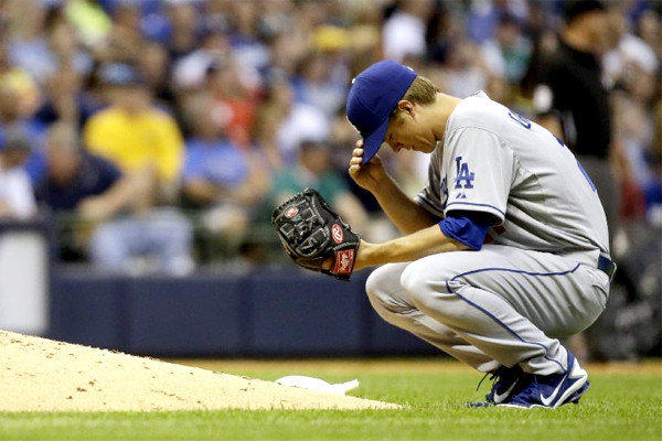 Zack Greinke had been perfect at Miller Park, but Tuesday the Brewers got the best of the Dodgers starter in L.A.'s 5-2 loss to Milwaukee.
