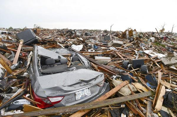 Entire neighborhoods in Moore, Okla., were destroyed by the tornado, which killed at least 24 people and injured at least 237.