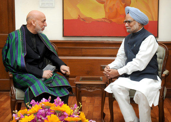 Indian Prime Minister Manmohan Singh, right, meets with Afghan President Hamid Karzai in New Delhi.