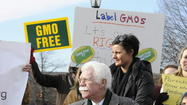 A bill that would require food made with genetically modified organisms to carry labels cleared the state Senate late Tuesday night.