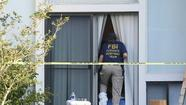 An FBI agent enters an apartment on Peregrine Avenue in Orange County after another agent shot and killed a man who had been questioned in connection with the Boston bombings.