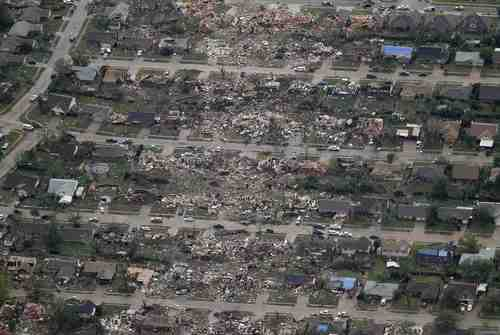 An aerial view shows the path of destruction in the aftermath of a tornado, at a neighborhood in Moore, Oklahoma May 21, 2013. Rescuers went building to building in search of victims and survivors picked through the rubble of their shattered homes on Tuesday, a day after a massive tornado tore through the Oklahoma City suburb of Moore, wiping out blocks of houses and killing at least 24 people.