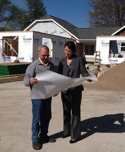 Valerie Snyder, (right) chair of the Charlevoix County Community Foundation board of trustees, takes a look at the drawings and the progress made on the construction for the new facility for the foundation with Floyd Wright, general contractor.