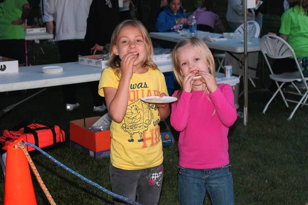 Two girls enjoy dinner at last year's Lagoon Fire on the Water. This year's event will include free balloon animals and a land-based fire pit for making s'mores. In previous years, the event has attracted 200 attendees.