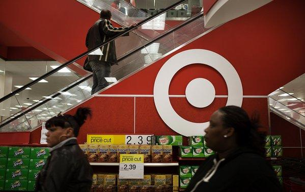 Target's earnings disappointed in the first quarter. The retailer lowered its full-year forecast.