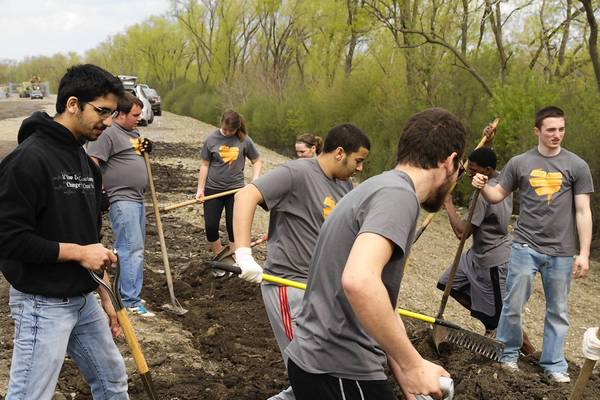 Students help clean up the Cal-Sag Trail during the recent Love Palos event in Palos Heights.