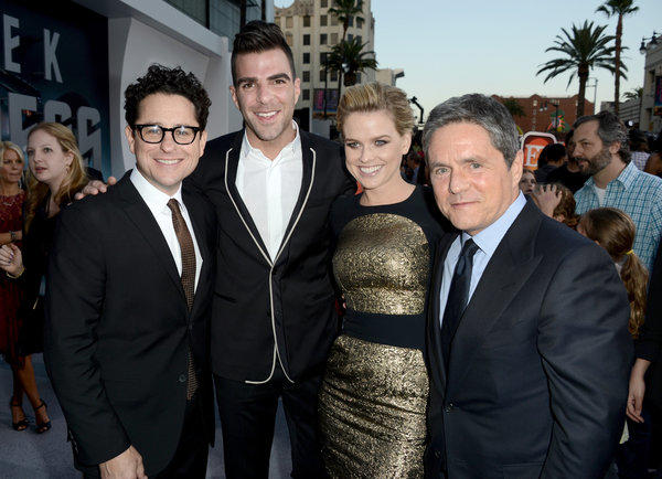 "Alice Eve was considerably more covered up at last week's premiere of ""Star Trek Into Darkness"" than she was in a scene from the film in which she wore lingerie. Posing with her, from left, are director J.J. Abrams, actor Zachary Quinto and Paramount Pictures Chairman Brad Grey."