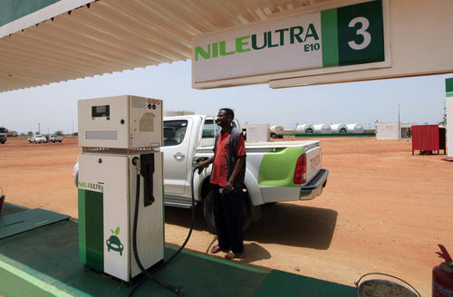 "A worker fills a pickup truck's tank with blended fuel at the first blended fuel station at Kenana Sugar Company's main plant, 170 miles south of Khartoum. Faced with the loss of most oil production after South Sudan seceded in 2011, Sudan has been scrambling to find new sources for state revenues and dollars to pay for imports. Developing its sugar industry is a priority as is searching for gold. To diversify its products, Kenana also plans to more than triple the output of biofuels, a by-product of sugar production, to 200 million liters by 2015. ""Ninety percent of our ethanol goes to the European Union, France, Holland,"" Ahmed Rabih, head of the ethanol business unit said."