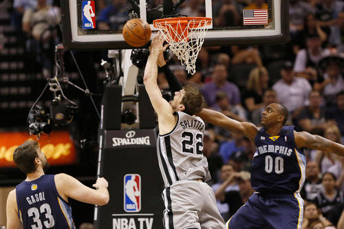San Antonio Spurs forward Tiago Splitter (22) is fouled while driving to the basket against Memphis Grizzlies forward Darrell Arthur (00) in game two of the Western Conference finals of the 2013 NBA Playoffs at AT&T Center.