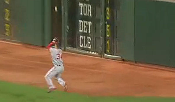 Washington right fielder Bryce Harper appears to flinch in mid-air well before reaching the outfield wall.