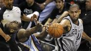 Spurs' Duncan andGrizzlies' Allen battle for the ball during the second quarter in Game 2 of their NBA Western Conference final playoff basketball series in San Antonio