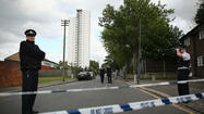 LONDON -- Two attackers wielding a number of weapons allegedly killed a man in broad daylight on a London street and then were shot by police Wednesday in an incident that may have been terrorism-related.