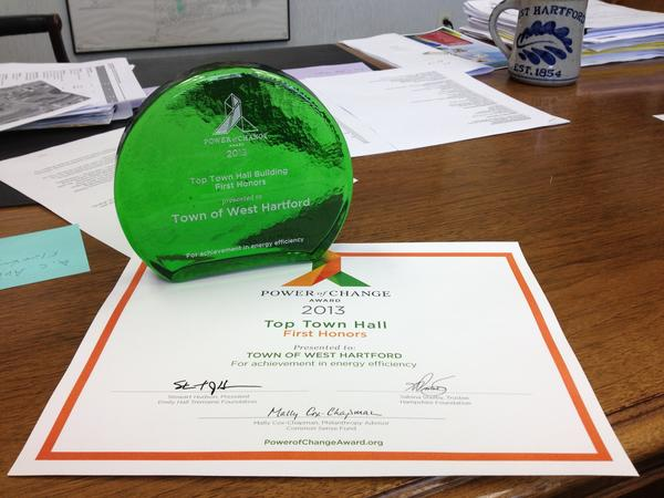 "The town's ""Top Town Hall Building"" Power of Change award statue and certificate are seen on Town Manager Ronald Van Winkle's desk."
