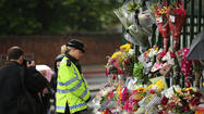 LONDON (Reuters) - A British soldier was hacked to death by two men shouting Islamic slogans in a south London street on Wednesday, in what the government said appeared to be a terrorist attack.