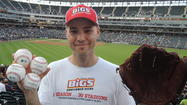 Glove in hand, backpack fastened around his shoulders, Zack Hample scans the field.