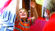 Ian Mitchell Henning, 7, of Laurel, plays with Center Ring Circus School owner Gregory May.